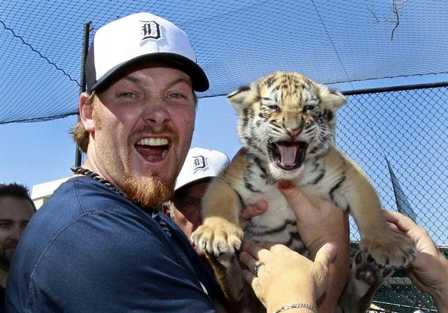 Phil Coke with 4 week old cub