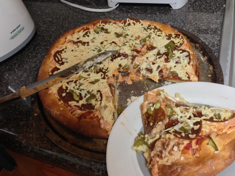 Vegan pizza made with Daiya shreds.