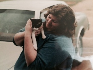 Me at age 21, wearing a man's sweatshirt. The kitty was Cagney.